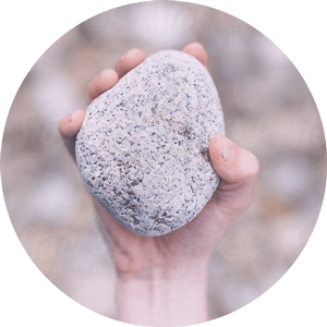 holding a stone
